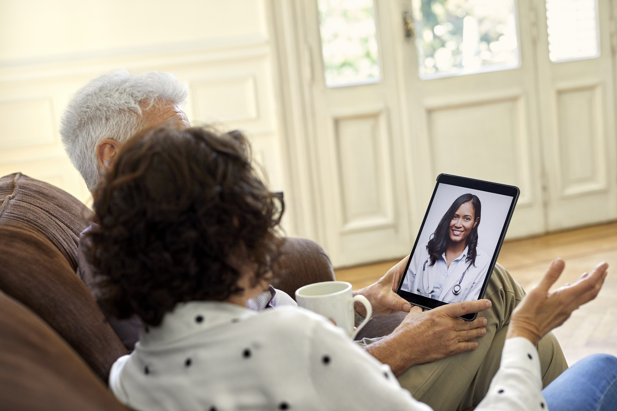 senior couple meeting with a doctor virtually