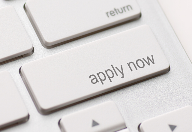 keyboard with apply now written on a key
