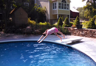 Maggie diving into a pool.