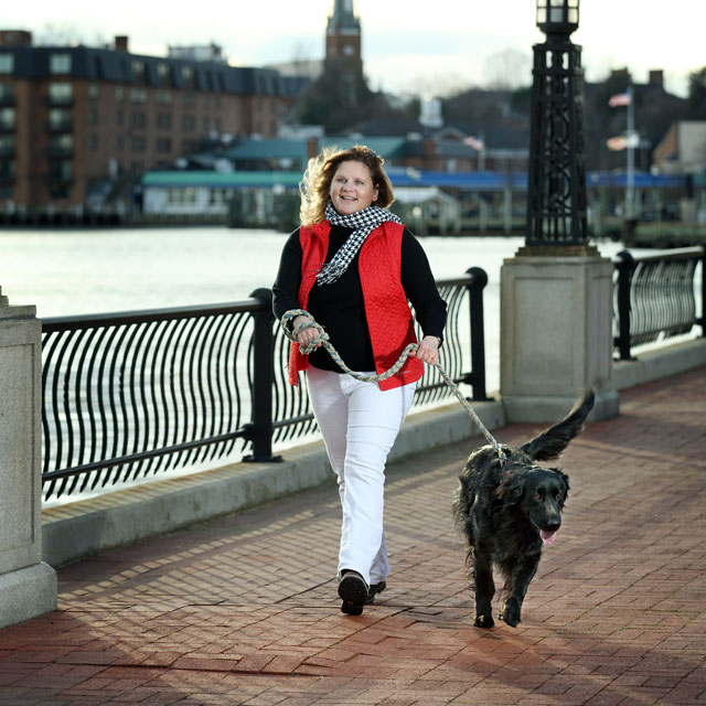 Mary Robertson walks her dog around the Annapolis Harbor