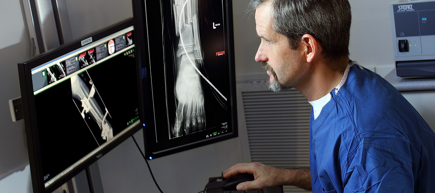 Dr. James Ficke examines an ankle x-ray