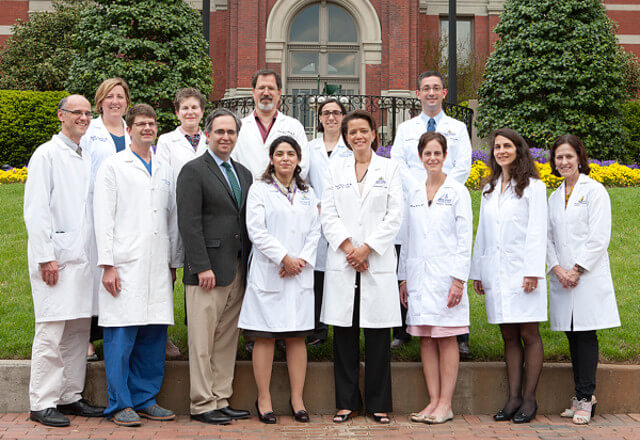 Sarcoma team standing on the stairs outside The Johns Hopkins Hospital.