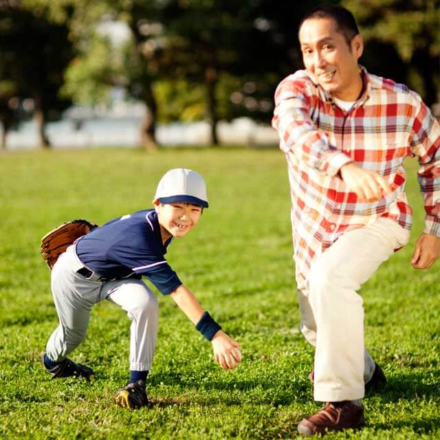 a father and son throwing baseballs