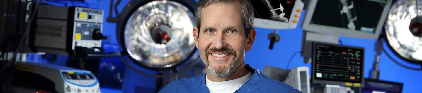Dr. James Ficke standing in an operating room.