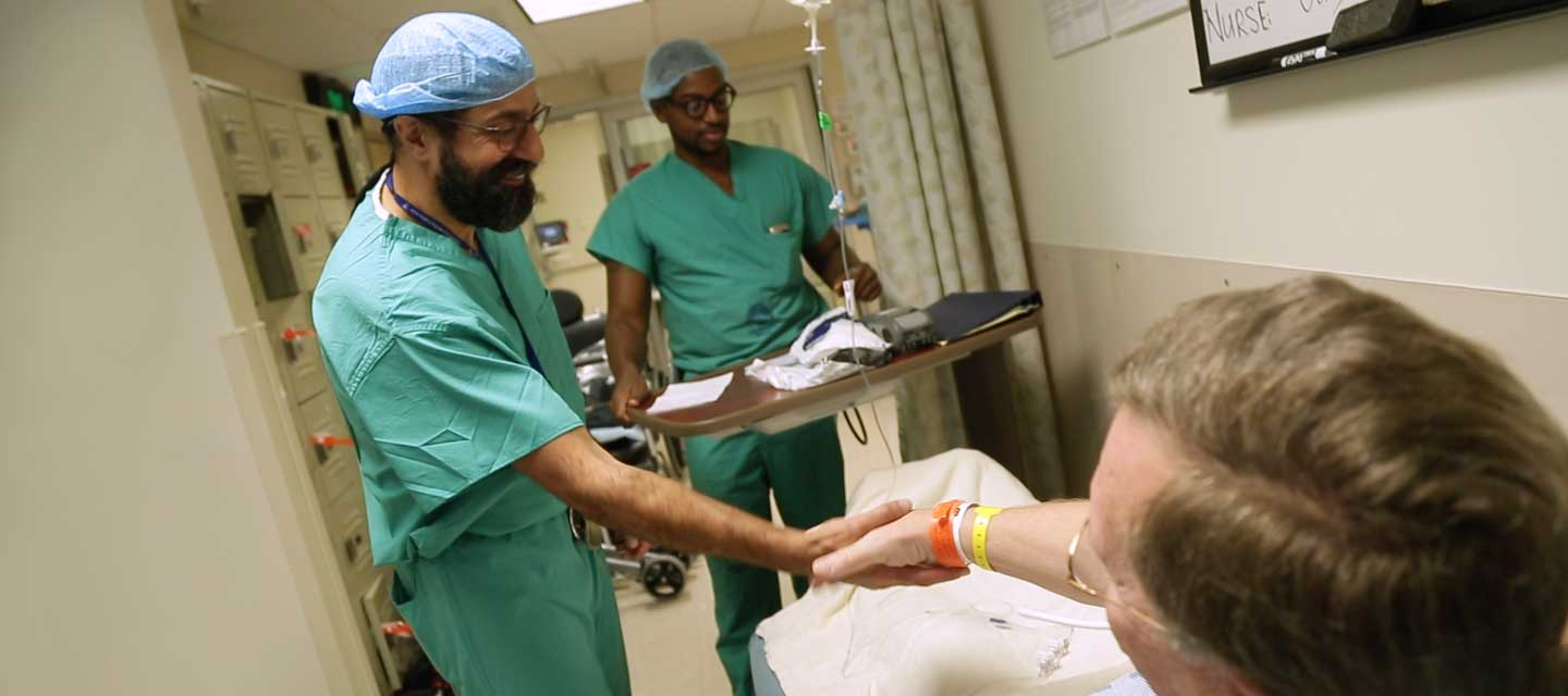 Doctor shaking hands with patient before surgery.