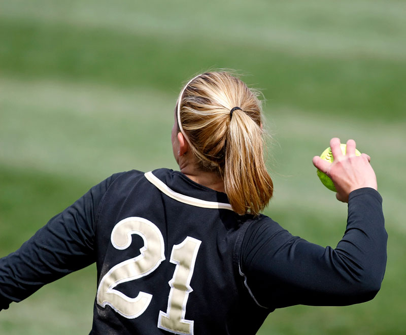 girl throwing a softball