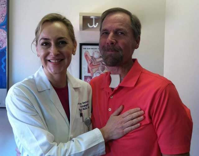 Steve, a Johns Hopkins patient, with Dr. Gourin