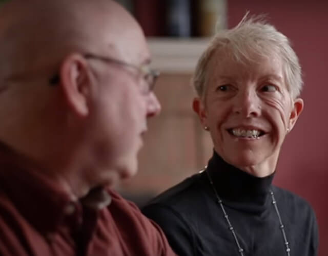 Kathy, a patient from the Johns Hopkins Facial Plastic and Reconstructive Surgery, with husband