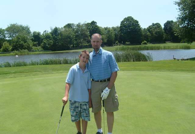 Johns Hopkins patient, Steve, playing golf with son