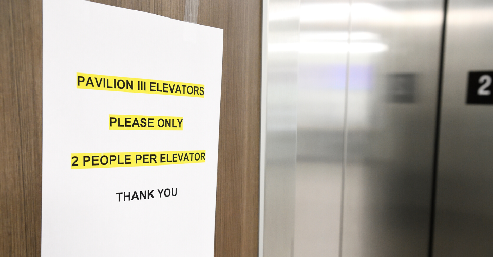 image of a sign about elevator restrictions