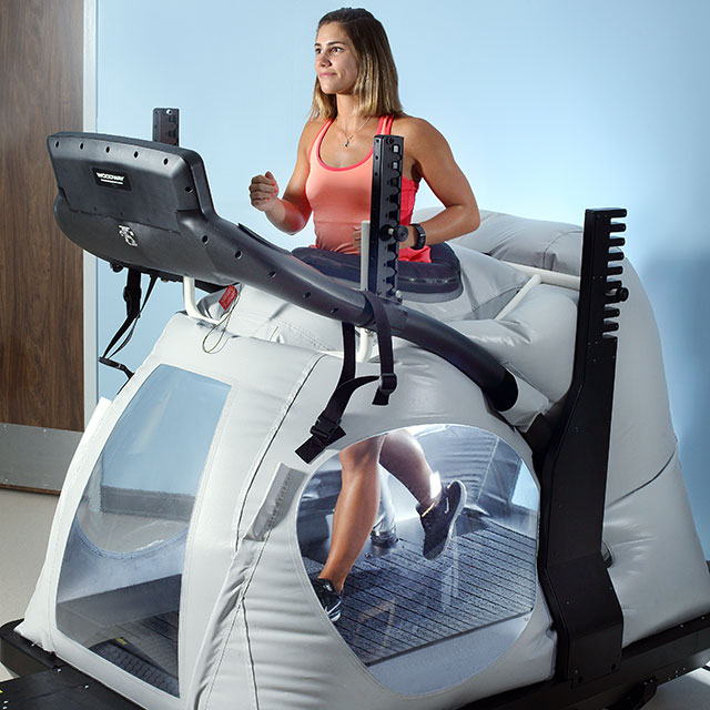 Patient using an anti gravity treadmill.