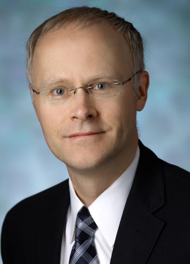 headshot of Dale Needham, F.C.P.A., M.D., Ph.D.