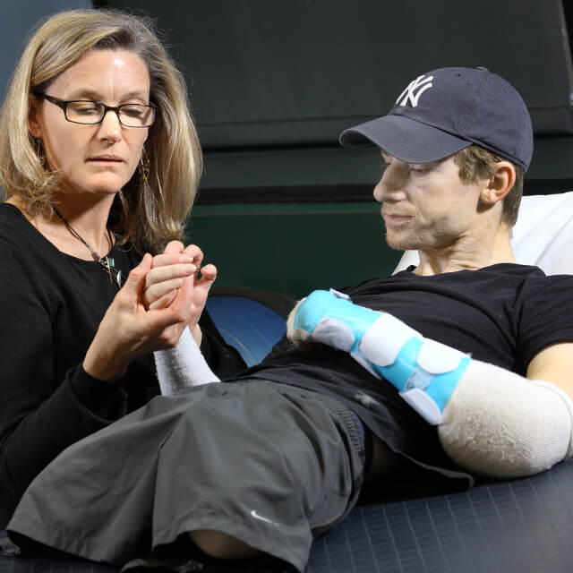 a therapist working with a hand transplant patient
