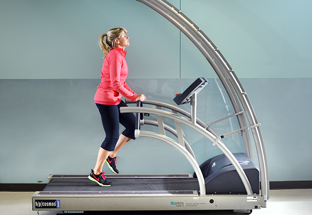 a woman running on a specialized treadmill