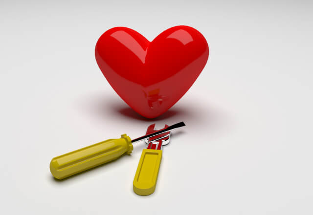 a heart with a wrench and screwdriver