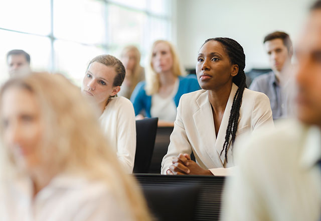 medical professionals listening to a presentation