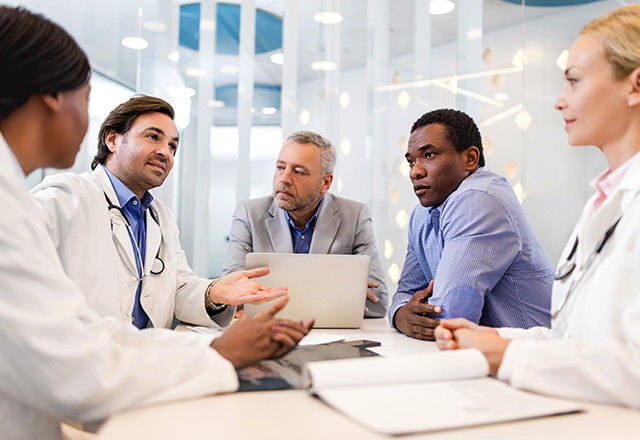 medical professionals and administrators in a meeting