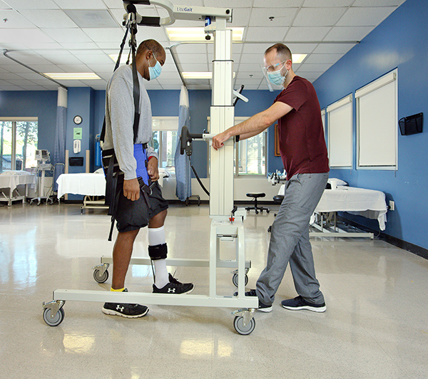 Inpatient rehabilitation working with a patient