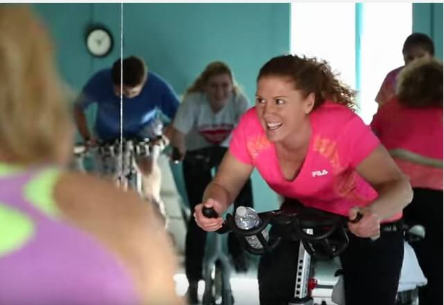 Pam Vierra on a stationary bike