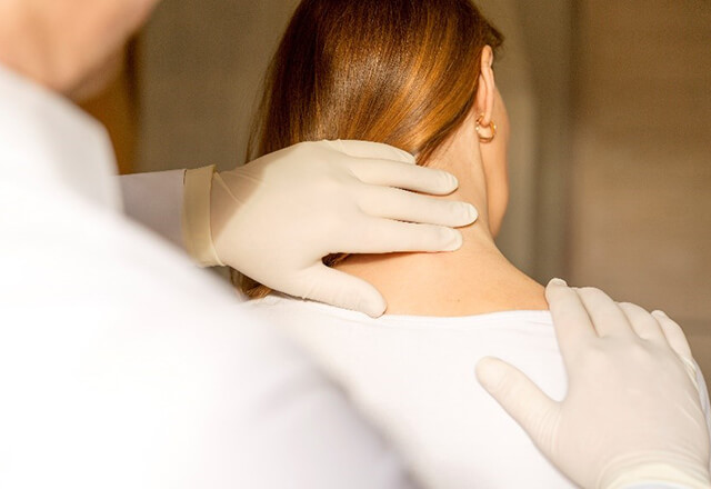 A patient's neck is examined