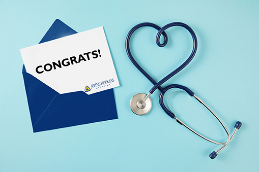 Congrats! note in envelope with stethescope in a heart shape