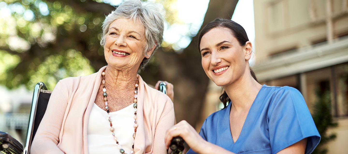 a caregiver with an elderly patient