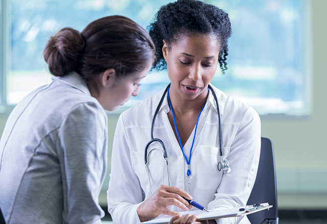 doctor discusses plan with patient