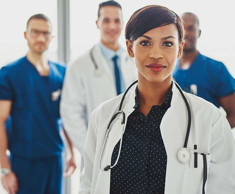 female doctor with other medical professionals