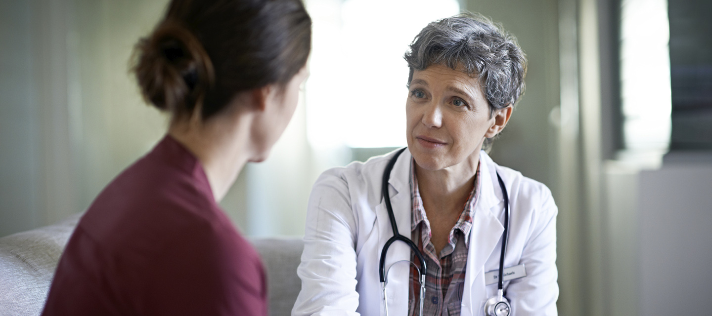 A doctor and patient in conversation.