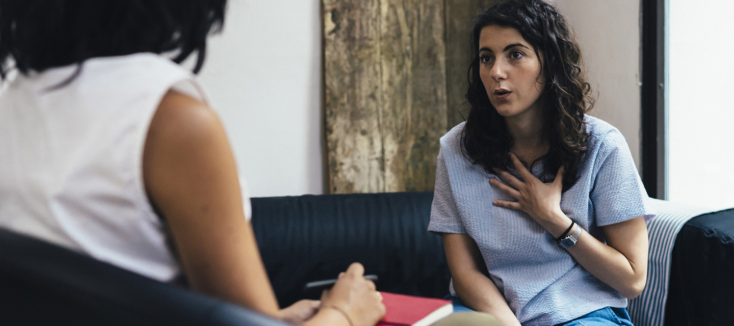 A woman speaks with her therapist.