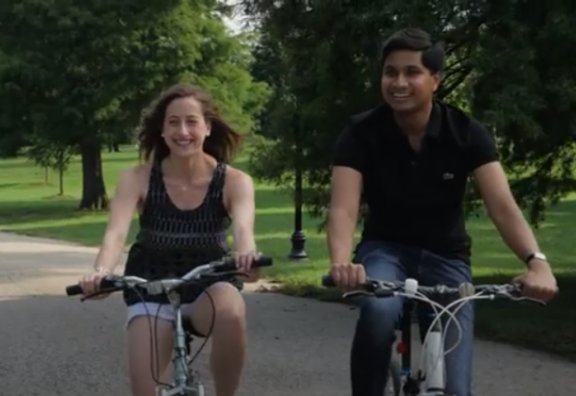 two people riding a bike through patterson park in baltimore