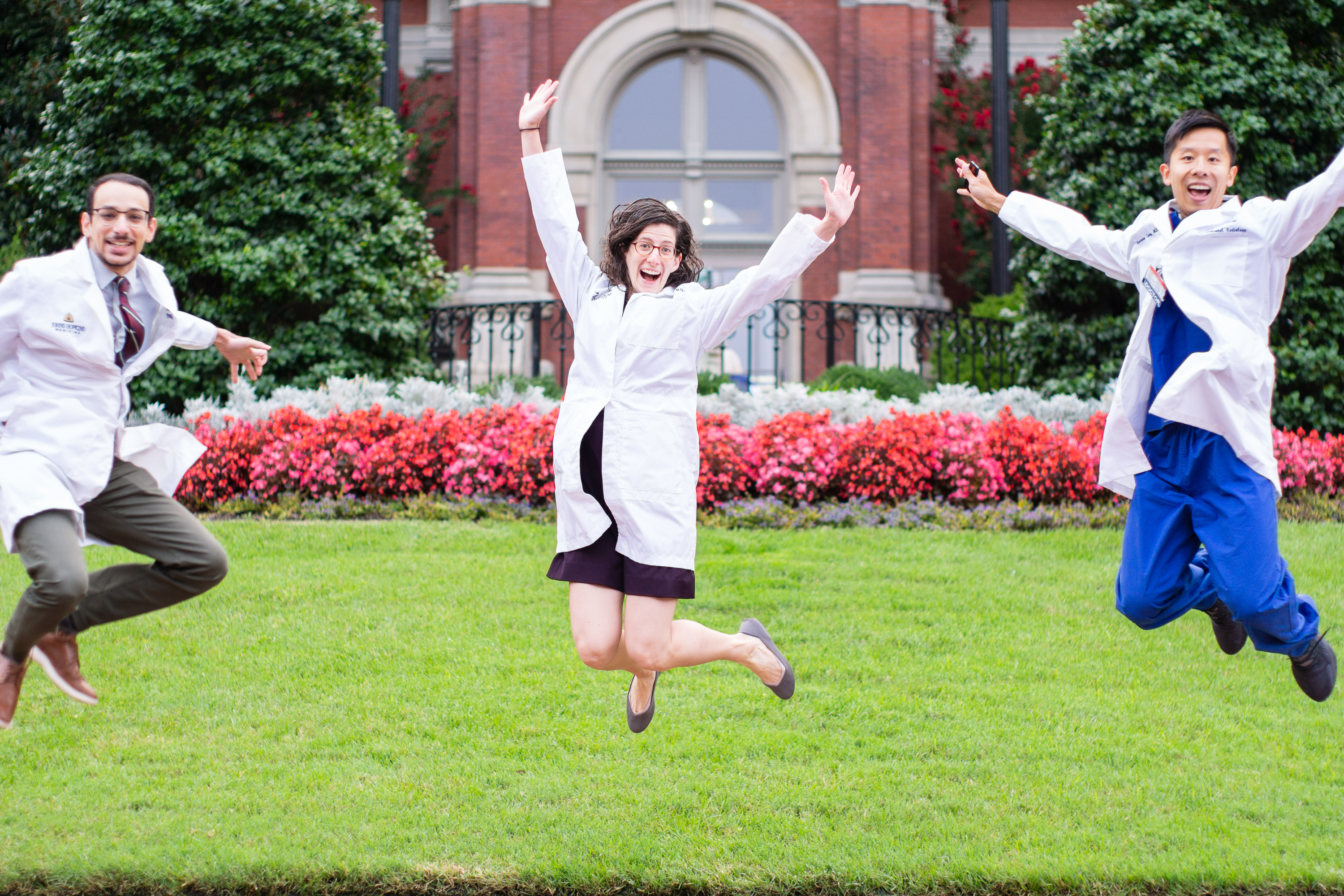 chief residents jumping in front of the dome building
