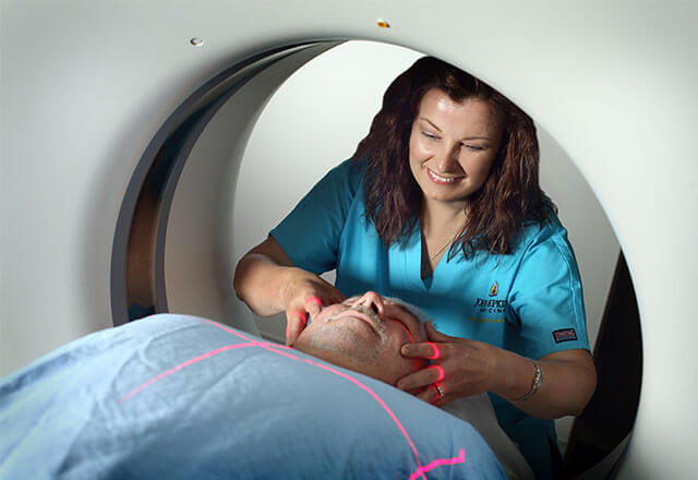 person getting a CT procedure