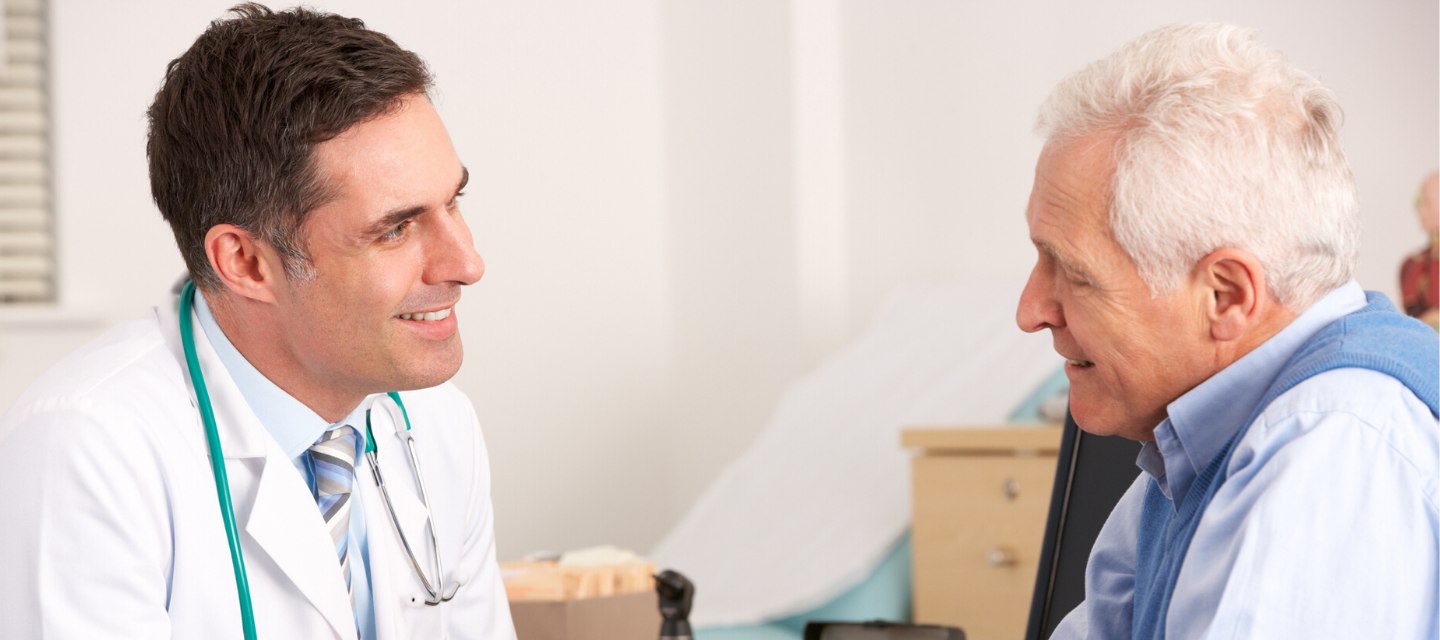 man speaking with doctor