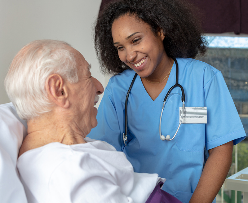 nurse laughing with patient