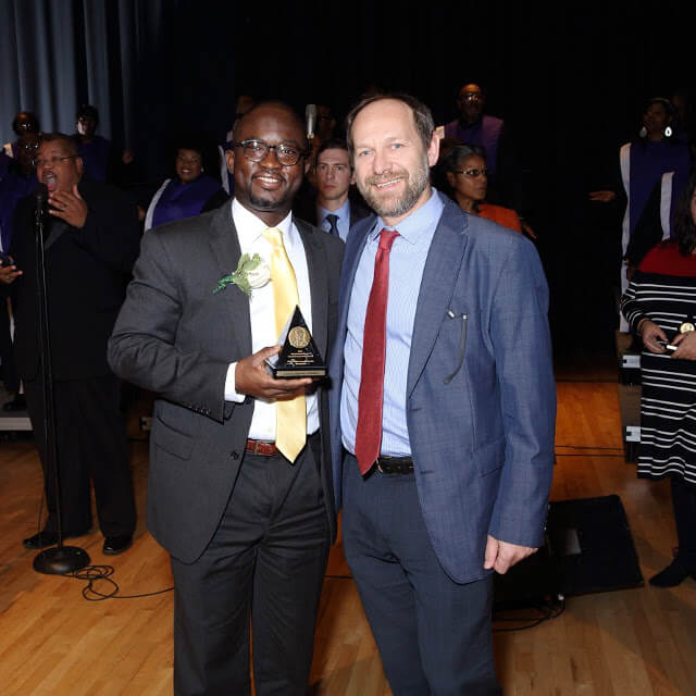 Charles Odonkor with Pablo Celnik at the award ceremony