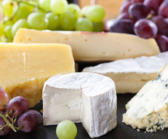 Platter of assorted cheeses, which contain lactose.