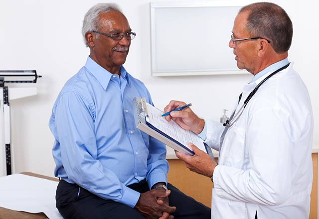 Doctor speaks with male patient.