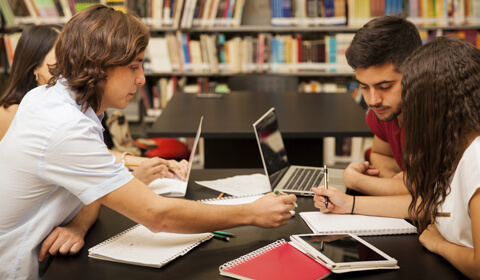 students studying in the library together