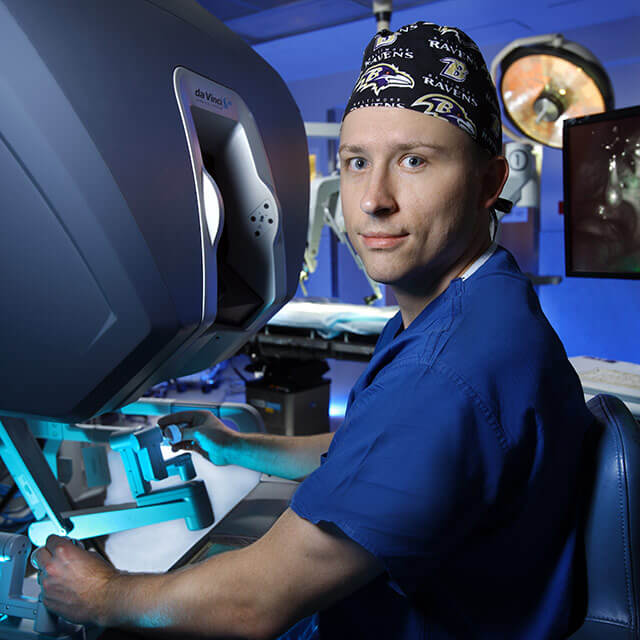 Dr. Edward Tanner operating a robotic surgery instrument