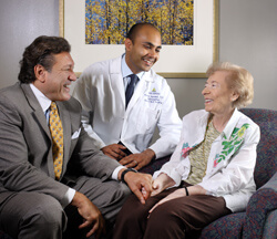When patient Sylvia Rinaldi (right) needed special care, Hopkins head and neck surgeon Nishant Agrawal was able to help.