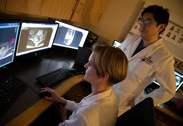 Dr. Redmond and Dr. Lo review imaging