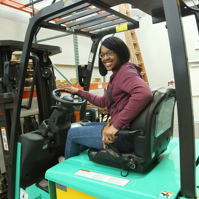 The photo shows Jasmine Montgomery on a forklift.