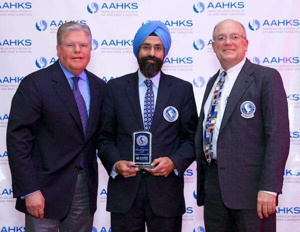 "Harpal ""Paul"" S. Khanuja, M.D., with representatives from AAHKS"
