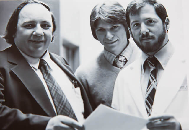 Black and white photograph of cancer researchers Donald Coffey, Drew Pardoll and Bert Vogelstein