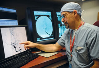 Doctor views stroke scan at a computer