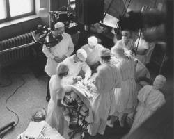 Photo of Dr. Blalock and his surgical team in the operating room.
