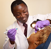 Dr. Kofi Boahene with a patient