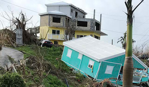 Homes damaged by hurricane.