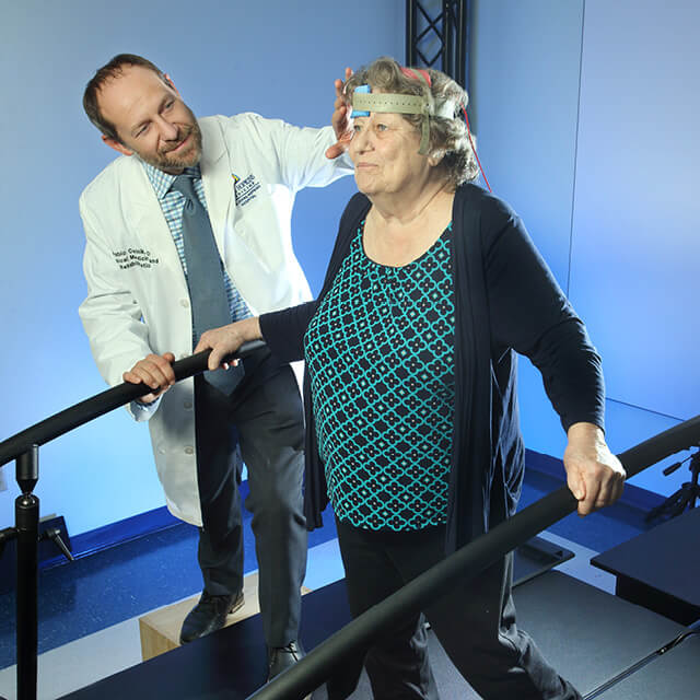 Pablo Celnik applies transcranial direct current stimulation to a research participant.